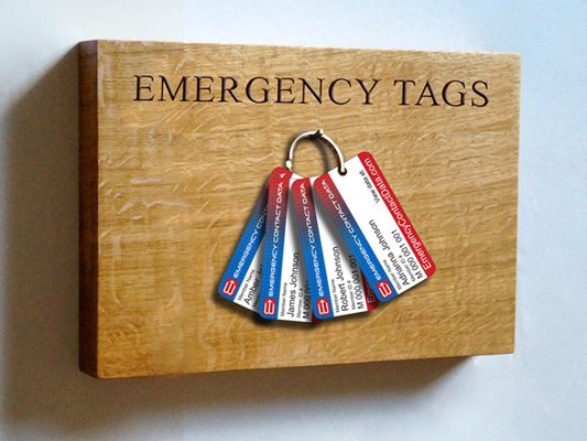 Attach each familiy member's Emergency Contact Data Keychain tag to one keyring and keep in a visible, central location within your home.